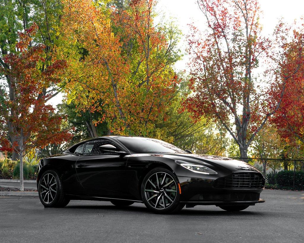 AstonMartin-DB11-Black-Outdoor-FallColors-Full.jpg